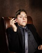 image of smoker  - Young cigar smoker sitting in arm - JPG