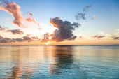 stock photo of cebu  - Beautiful sunrise over sea water in Philippines Oslob city Cebu island - JPG