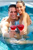 picture of hot-tub  - Young couple relaxing in hot tub - JPG