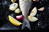 picture of bass fish  - Fried Fish on a baking sheet seafood - JPG