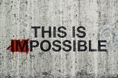 image of impossible  - This is Impossible Concept with Graffiti on Gray Cement Street Wall - JPG