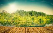 stock photo of pier a lake  - Colourful lake landscape with a bamboo pier - JPG