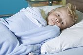 pic of sick  - A sick little boy in a hospital bed - JPG