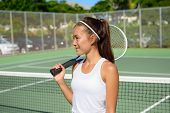 Постер, плакат: Female tennis player portrait with tennis racket outdoors in tennis court in summer Fit female athl