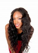 picture of black american  - A lovely young African American woman with long curly black hair