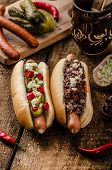 picture of wiener dog  - Chilli and vegetarian hot dog home pickles beef meat and homemade barbeque souce - JPG