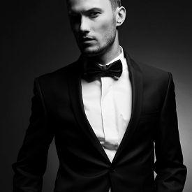 picture of adults only  - Portrait of handsome stylish man in elegant black suit - JPG