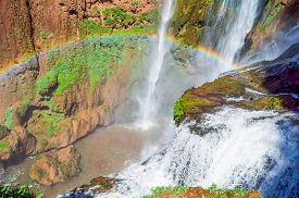 stock photo of rainbow piano  - Ouzoud waterfalls located in the Grand Atlas village of Tanaghme with rainbow - JPG
