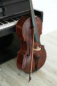 pic of cello  - Cello near piano - JPG