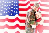 foto of reunited  - Solider reunited with mother against rippled us flag - JPG