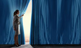 foto of curtains stage  - Young woman in business suit opening color curtain of stage - JPG