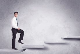 stock photo of step-up  - Business person stepping up a staircase - JPG