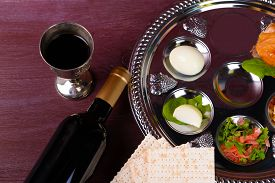 picture of seder  - Matzo for Passover with Seder meal with wine on plate on table close up - JPG