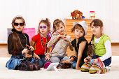 Five fashionable little girls with stylish accessories on