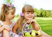 foto of cute little girl  - Two sweet kids in garden with fruit basket beside - JPG