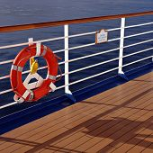stock photo of life-boat  - Cruise ship railing and life buoy - JPG