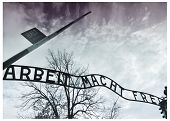 stock photo of hitler  - The sign above the main gate at Auschwitz Nazi Concentration Camp - JPG