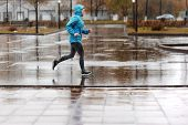 Runner Woman Running In Park In The Rain. Jogging Training For Marathon. poster