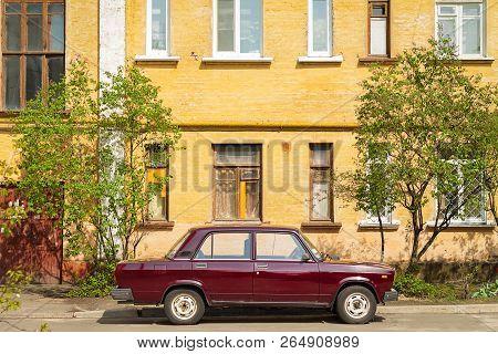 Vintage Car Parked Near Old