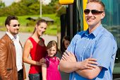 picture of bus driver  - Passengers boarding a bus at a bus station - JPG