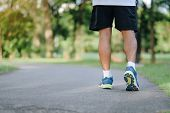 Young Fitness Man Legs Running In The Park Outdoor, Male Runner Walking On The Road Outside, Asian A poster