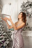 Christmas Winter Woman Holding Magic Christmas Gift Box. Beautiful New Year And Christmas Tree. Beau poster