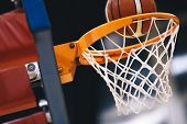 Basketball Scoring Basket At A Sports Arena. Scoring The Winning Points At A Basketball Game. The Or poster