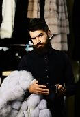 Businessman With Cash And Expensive Overcoat. Guy With Beard Buys Furry Coat. Fashion And Shopping C poster