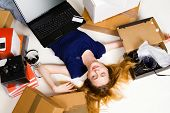 Young girl surrounded with her delivered online orders