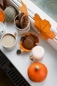 Still Life Composition On The Windowsill, Autumn Dry Leaves, Scented Candles, Cup Of Hot Tea, Books. poster