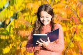 There Is No End To Education. Small Child Read Book On Autumn Day. Small Child Enjoy Reading On Autu poster