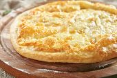 Megrelian Khachapuri Made From a Delicious Tender Dough with Melted Burnt Imeretian Cheese and Butte poster