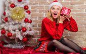 Girl Celebrate Near Christmas Tree. Unpacking Christmas Gift. Lady Celebrate Christmas. Winter Holid poster
