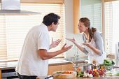 Young couple having a fight in the kitchen