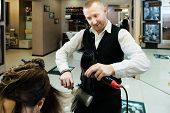 Funny Photo - An Involved Hair Master Drying His Clients Hair Enthusiastically poster