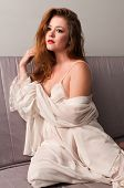 picture of futon  - Pretty young brunette in a cream lingerie - JPG