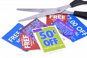 foto of save money  - clipping coupons to save money at the grocery store - JPG