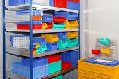 pic of shelving unit  - All shapes and sizes of colorful bins and crates - JPG
