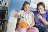 pic of obesity children  - Mother And Daughter Watching TV - JPG