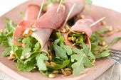 foto of crudites  - Appetizer with ham rolls and rocket salad covered with pineseeds - JPG