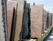 image of slab  - Colorful granite slabs for sale in store show room - JPG
