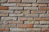 foto of sandblasting  - Symmetrical wall of clay bricks red sandblasted - JPG