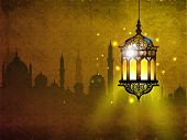 image of arabic calligraphy  - Hanging iIlluminated intricate Arabic Lamp with on shiny abstract night background for Ramadan Kareem - JPG