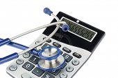 pic of diagnostic medical tool  - stethoscope and calculator - JPG