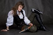 pic of crossed pistols  - Girl on black with pistol and pirate hat - JPG