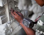 stock photo of chisel  - Hand of the master at work  - JPG