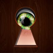 Interested Eye looking in keyhole