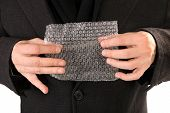 stock photo of bubble sheet  - Hands are popping bubble wrap sheet - JPG