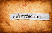 stock photo of overhauling  - Imperfection title on old grunge paper background - JPG