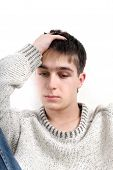 stock photo of pity  - sad young man portrait on the white background - JPG